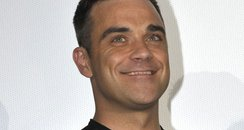 Robbie Williams attends Cars 2 Premiere