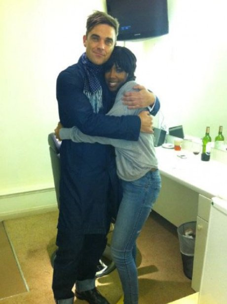 Kelly Rowland and Robbie Williams hugging