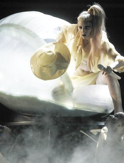 Lady Gaga hatches from an egg at the Grammys