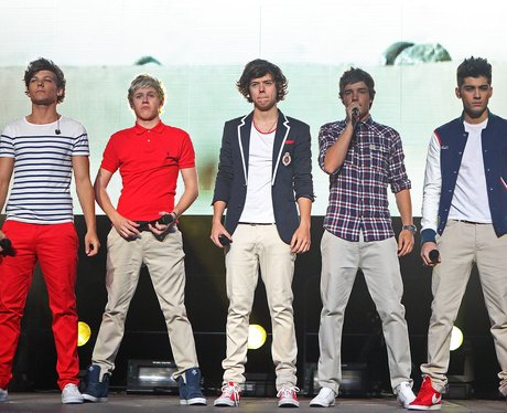 One Direction perform live on stage.