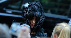 Lady Gaga wears feather hat