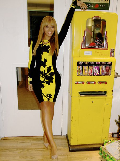 Beyonce in a black and yellow dress