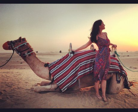 Katy Perry with a camel in Dubai