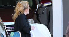 Adele carrying her baby in America