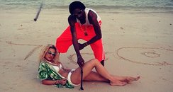 Rita Ora with snoop dog on the  beach