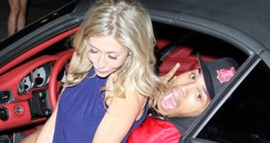 Chris Brown poses with a mystery blond girl