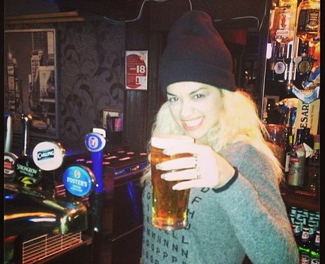 Rita Ora serving a pint