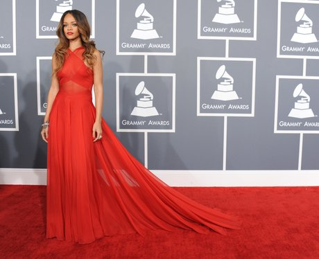 Rihanna wearing a red dress arrives at the Grammy Awards 2013