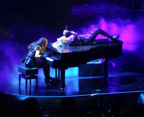 Beyonce lying on a piano