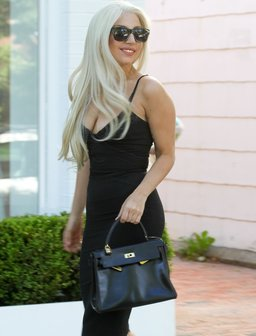 Lady Gaga wearing a tight black dress