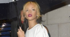 Rihanna holding an umbrella
