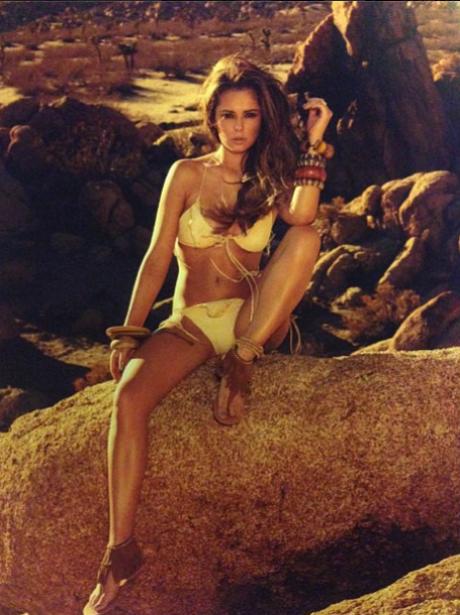 Cheryl Cole dressed like a cavegirl