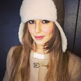 Cheryl Cole wearing a winter hat