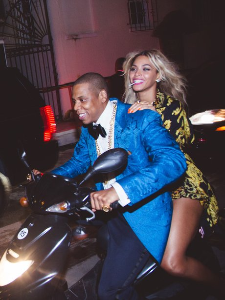 Beyonce and Jay Z riding a motorbike