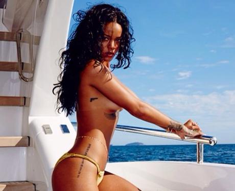 Rihanna posing topless in a bikini