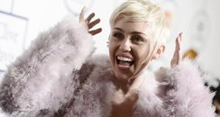 Miley Cyrus on the red carpet of pre-grammys party
