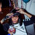 Image 1: Rihanna drinking and straightening her hair