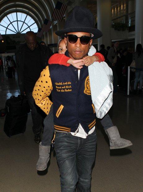 Pharrell Williams and Child Piggy Back