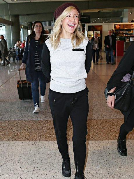 Ellie Goulding laughing at the airport