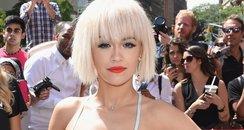 Rita Ora wearing  a metalic dress