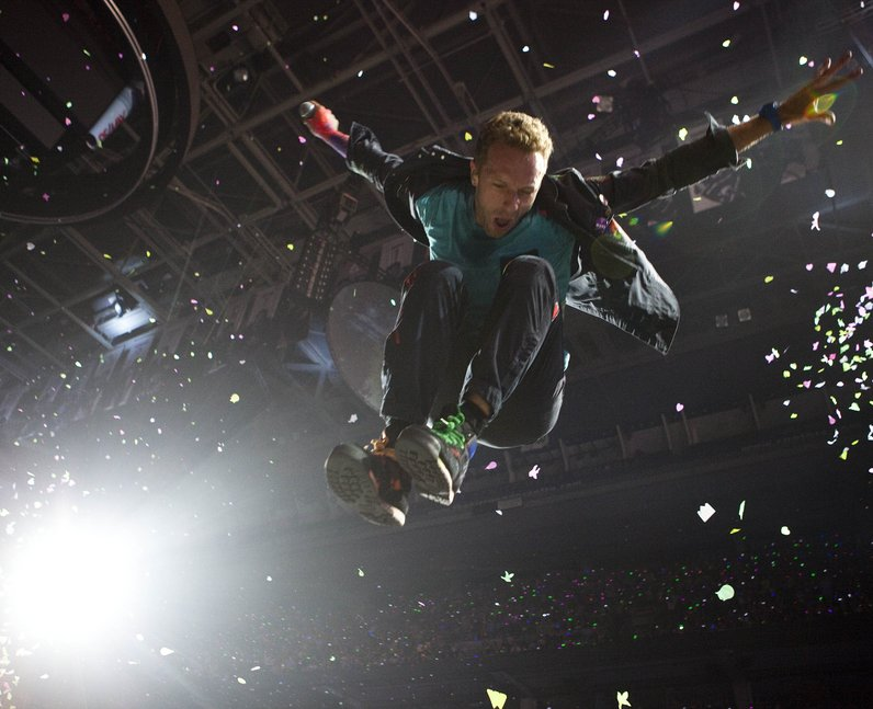 Coldplay Chris Martin Jumping