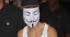 Justin Bieber wearing a mask