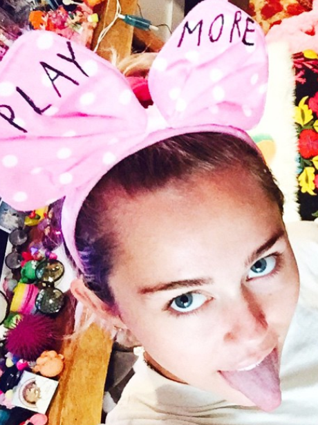 Miley Cyrus wearing mouse ears