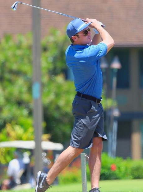 Zac Efron playing golf