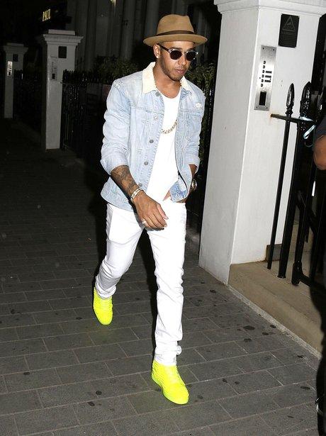 Lewis Hamilton wearing flurorescent trainers