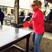 Image 2: Rita Ora plays ping pong in red jumper