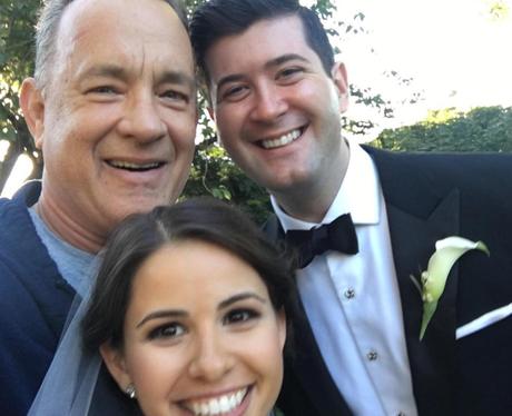 Tom Hanks photobombs at a wedding